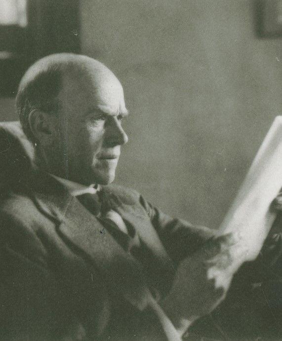 Photo of Elton Mayo reading newspaper